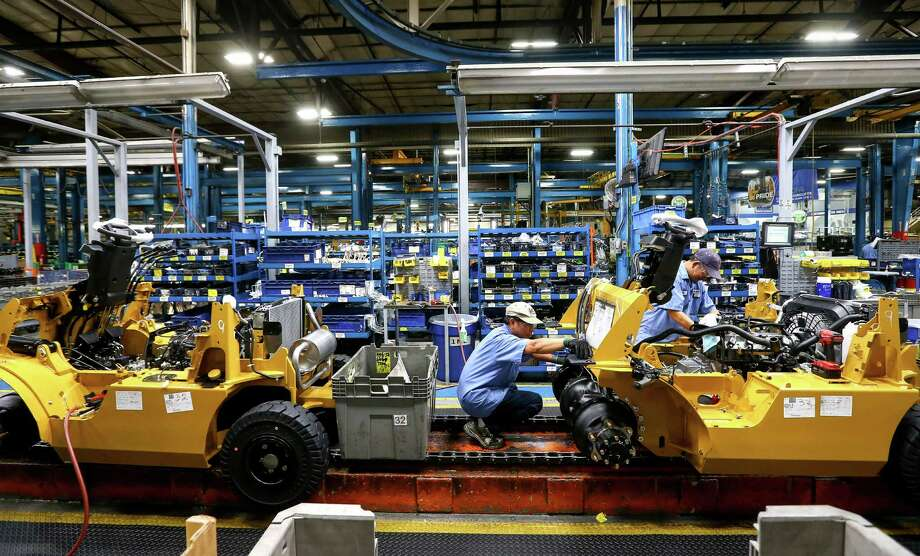 Workers assemble forklifts at a Mitsubishi Caterpillar Forklift America plant on the northwestern edge of Houston. Photo: Jon Shapley, Staff / © 2015  Houston Chronicle