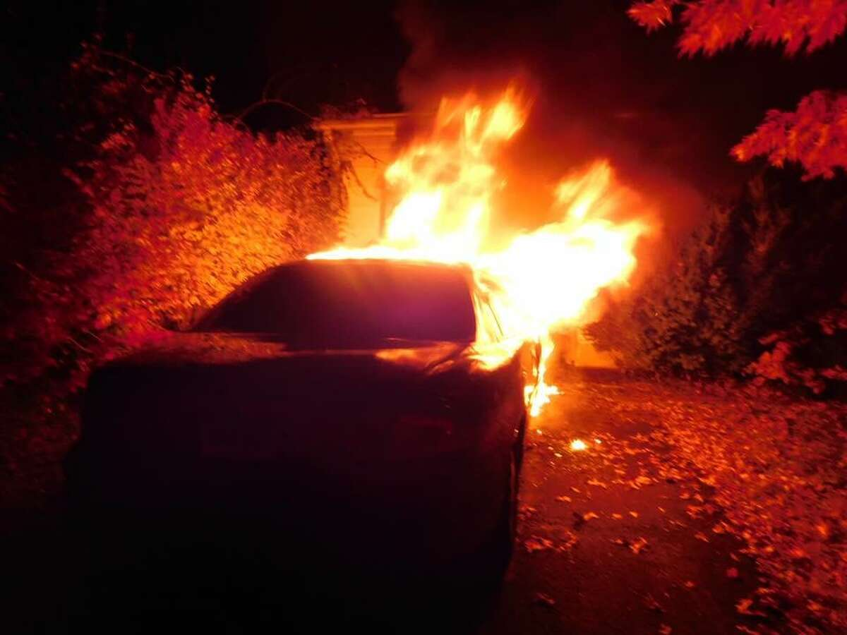 Oxford firefighters responded to a car fire on Thursday, Nov. 10, 2016 on the corner of Peach Farm and Great Hill roads. The car was parked 10 feet from the house, causing smoke conditions inside the home.