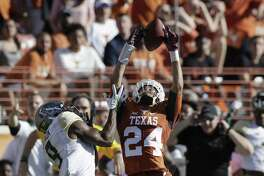 Texas cornerback John Bonney (24) breaks up a pass intended for Baylor wide receiver KD Cannon (9) during the first half on Oct. 29, 2016, in Austin.