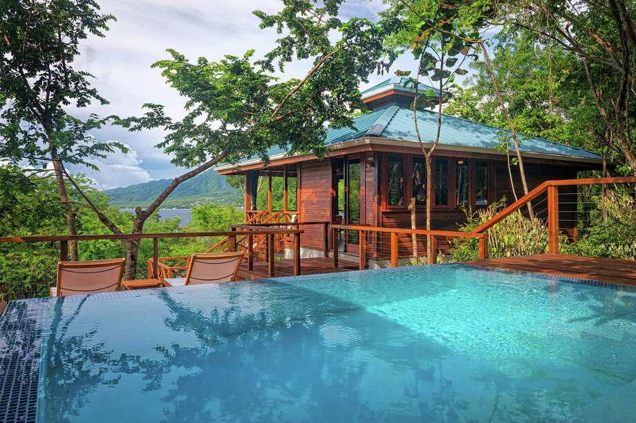 Above: Secret Bay Resort's treehouse villas, in Dominica, are luxe and secluded but keep a small footprint. Left: Villa guests can enjoy a private pool. Photo: Secret Bay / Bloomberg