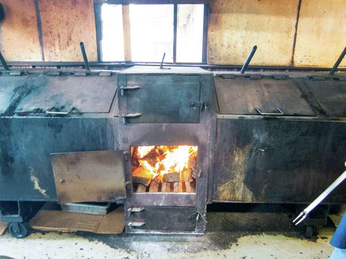 The custom built, central firebox smoker at the Swinging Door in Richmond