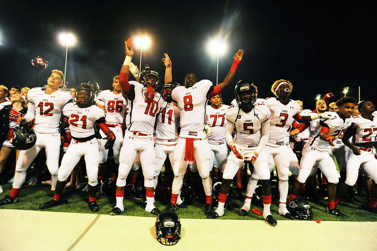 The Langham Creek Lobos celebrate their dominant, 50-13 bi-district win against Houston Heights Thursday at Delmar Stadium. The Lobos held the edge in virtually every facet of play, earning the program's first playoff win since 2012.