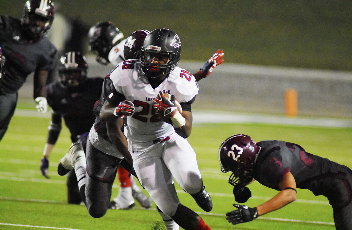 Langham Creek senior running back Toneil Carter jukes his way to a first down Thursday night against Houston Heights. Carter had 123 all-purpose yards and two touchdowns in the 50-13 win.