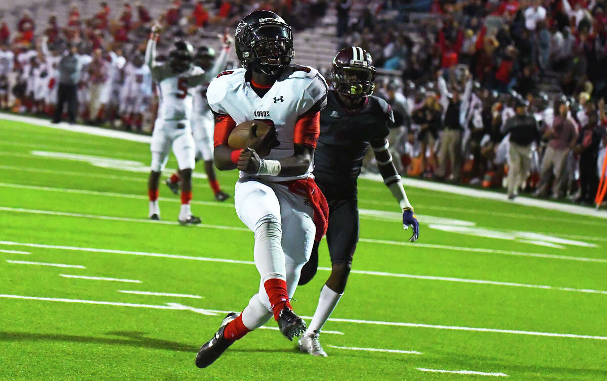 Langham Creek sophomore quarterback Chris Herron rushes in for a touchdown against Houston Heights Thursday. Herron was 8-of-12 passing for 168 yards and three touchdowns, and was also the game's leading rusher with 112 yards on 18 attempts and two touchdowns on the ground.
