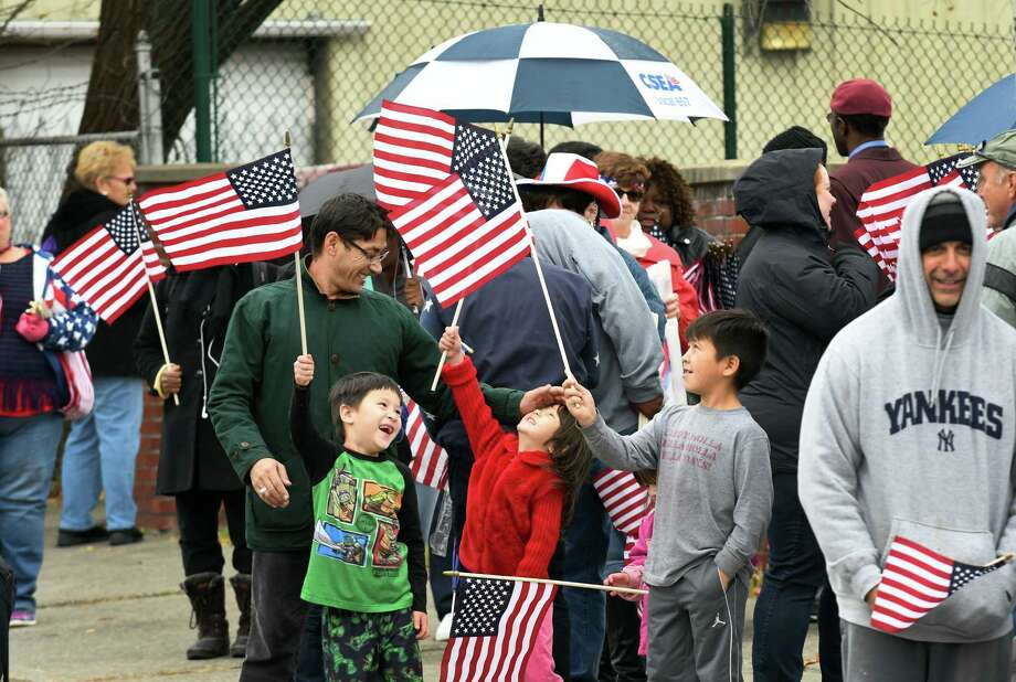 A patriotic crowd gathers along Central Avenue to watch the 62nd annual Veterans Day parade on Friday Nov. 11, 2016 in Albany, N.Y. (Michael P. Farrell/Times Union) Photo: Michael P. Farrell / 20038749A