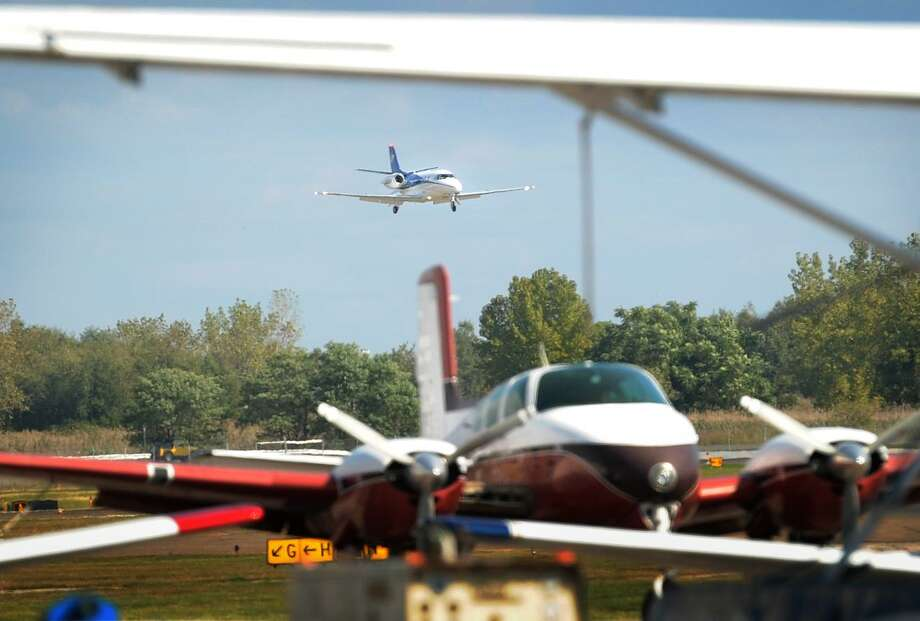 A small jet containing Bridgeport Mayor Joe Ganim and a city delegation lands on the newly reconstructed Runway 6-24 for a re-opening ceremony at Sikorsky Memorial Airport in Stratford, Conn. on Monday, October 3, 2016. Photo: Brian A. Pounds / Hearst Connecticut Media / Connecticut Post