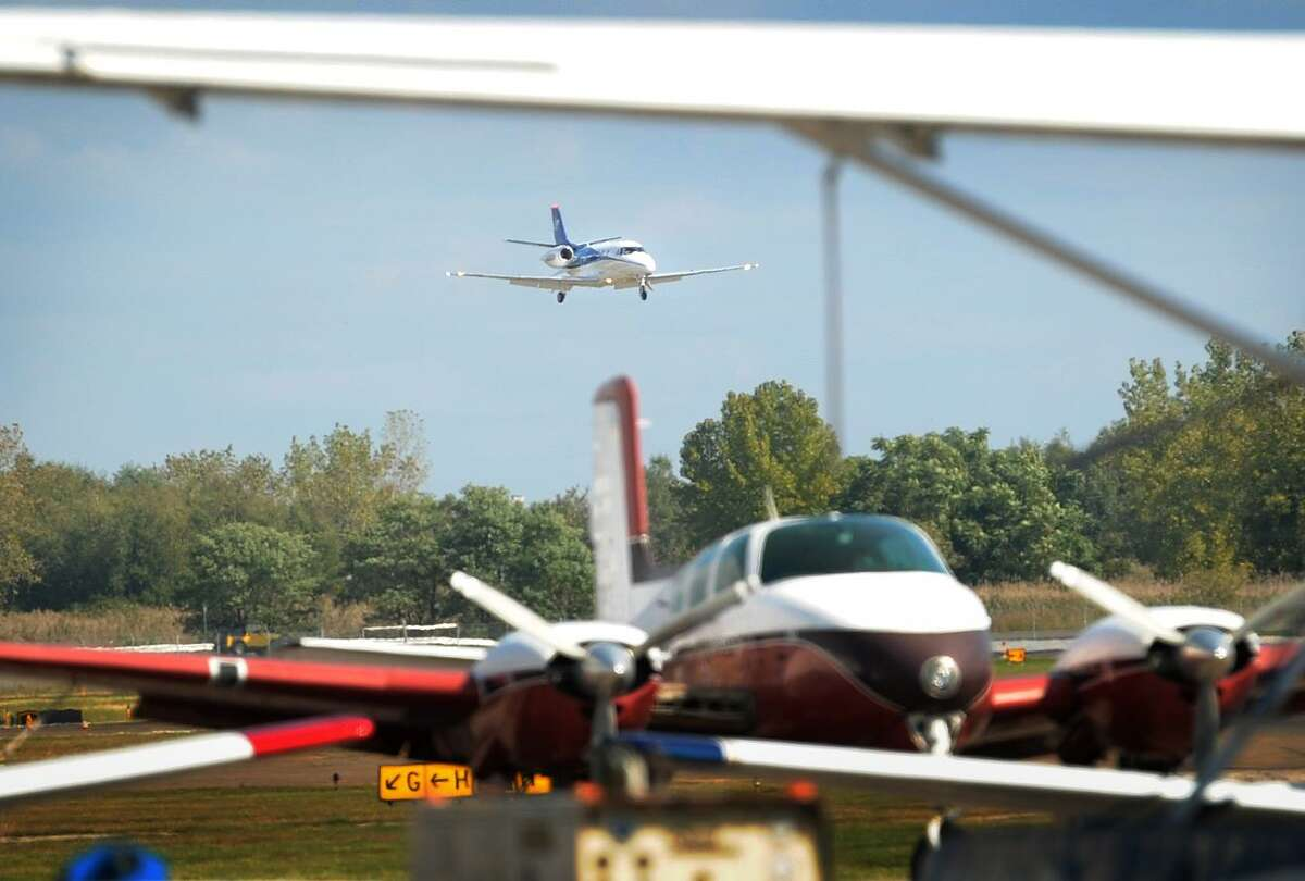 A small jet containing Bridgeport Mayor Joe Ganim and a city delegation lands on the newly reconstructed Runway 6-24 for a re-opening ceremony at Sikorsky Memorial Airport in Stratford, Conn. on Monday, October 3, 2016.