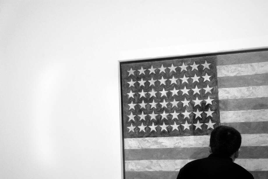 """Flag,"" 1958, by Jasper Johns, at the San Francisco Museum of Modern Art. Photo: CHRISTINA KOCI HERNANDEZ, CHRONICLE"