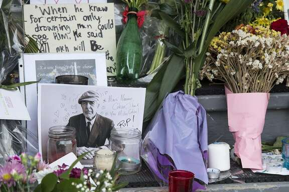 "A makeshift shrine is seen in front of the home of legendary singer and poet Leonard Cohen Friday, Nov. 11, 2016 in Montreal. Cohen, the baritone-voiced Canadian singer-songwriter who seamlessly blended spirituality and sexuality in songs like ""Hallelujah,"" ''Suzanne"" and ""Bird on a Wire,"" has died at age 82, his son said. (Paul Chiasson/The Canadian Press via AP)"