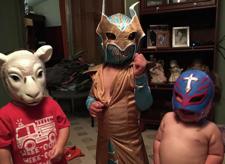 Express-News readers attempt to win tickets to the WWE Royal Rumble, here in San Antonio next January, by posting videos of themselves impersonating wrestlers to Facebook. Photo: Facebook Screen Grab