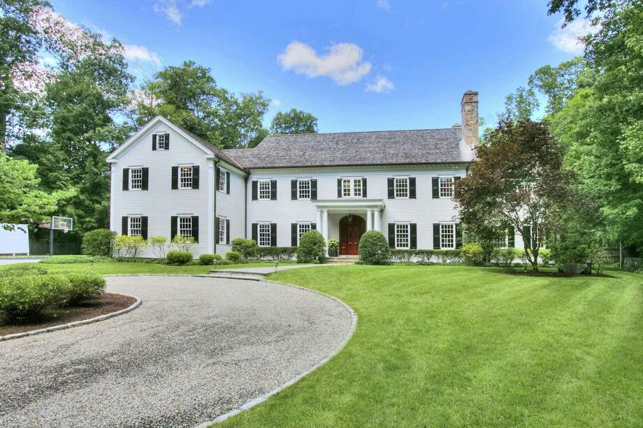The 16-room colonial house at 40 Blueberry Lane sits on a 2.5-acre property at the end of a cul-de-sac on a quiet horseshoe-shaped street. Photo: Contributed Photos