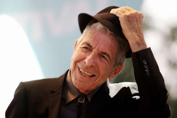 FILES) This file picture dated July 22, 2008 shows Canadian singer Leonard Cohen performing during the Nice Jazz Festival, in Nice, southern France. Canadian singer-songwriter Leonard Cohen, who turns 75 on September 21, 2009, was released from a hospital in Spain on September 19, 2009, hours after collapsing on stage during a concert, hospital sources said. Organisers of his concert in the eastern city of Valencia said he had fainted on stage after being stricken with food poisoning.AFP PHOTO VALERY HACHE (Photo credit should read VALERY HACHE/AFP/Getty Images)