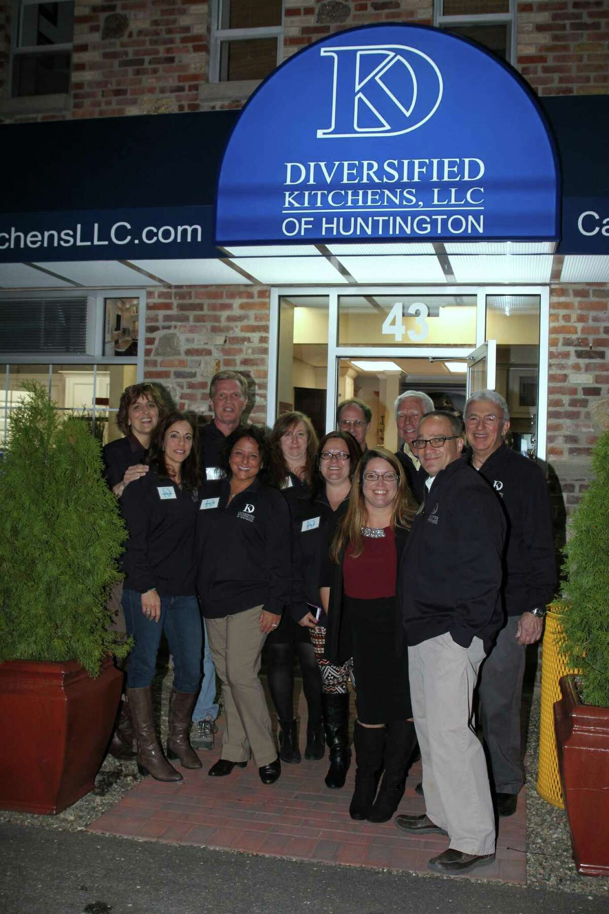 Diversified Kitchens of Shelton celebrates the opening of its new space at Huntington Plaza.