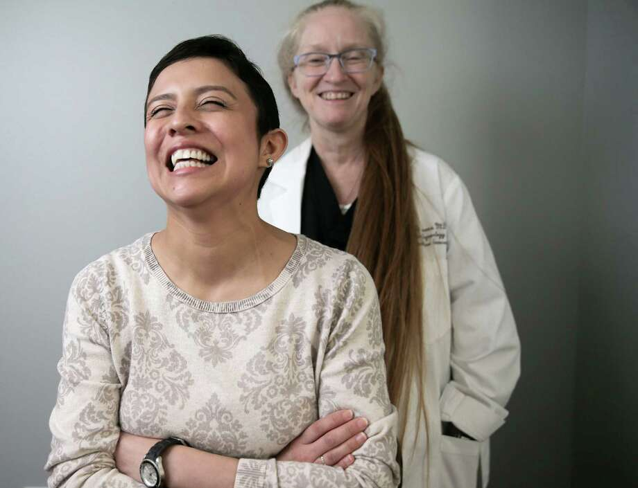 When Marcela Rodriguez, left, got breast cancer diagnosis while pregnant, Dr. Pamela Berens assembled a team to fight for her. Photo: Elizabeth Conley, Staff / © 2016 Houston Chronicle