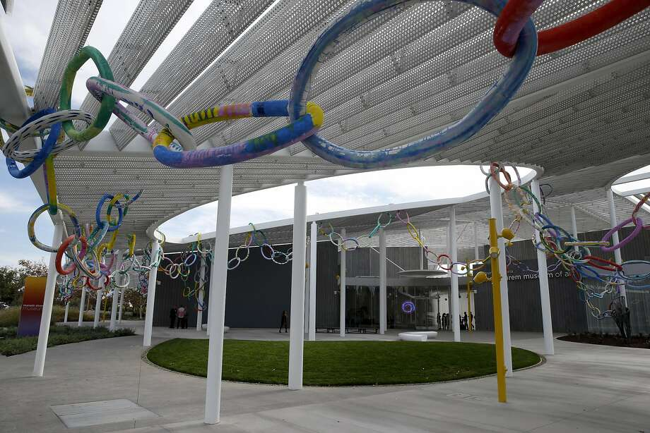 A chain of foam links by artist Lisa Rybovich Cralle is woven through horizontal aluminum beams on the grand canopy above the main plaza of the Manetti Shrem Museum of Art at UC Davis. Photo: Paul Chinn, The Chronicle