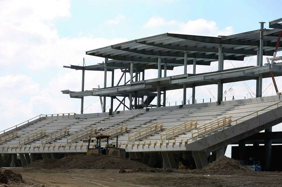 Construction equipment resting on the site of the new Katy Independent School District football stadium is seen Sunday, Oct. 30, 2016, in Katy. The costs related to the new stadium keeps climbing and when it is finished, the total cost is expected to top $72 million - making it the costliest stadium in the state. (Yi-Chin Lee / Houston Chronicle ) Photo: Yi-Chin Lee, Staff / © 2016  Houston Chronicle