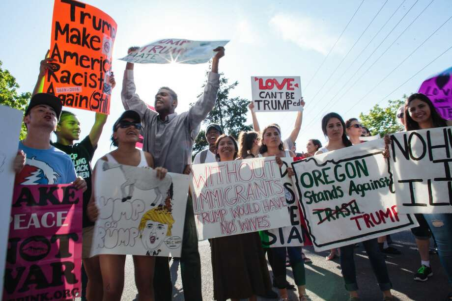 Protesters are shown at a Donald Trump rally in Eugene, Oregon, in May. Oregon isn't the only state where there's secession talk. Some Californians also want to secede because of Trump's victory. Talks of secession have existed in Texas for years, even before Trump was a candidate for president.Which state would make a better country? Texas or California?Click through the slideshow to see if the Lone Star State or the Golden State would make for a better country after secession.  Photo: ROB KERR/AFP/Getty Images