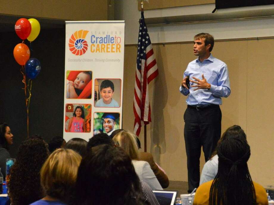 Jeff Edmondson, managing director of StriveTogether, addresses a crowd of educators, officials and community leaders during the official launch this week of Stamford Cradle to Career. Photo: Contributed Photo / Sofia Dupi