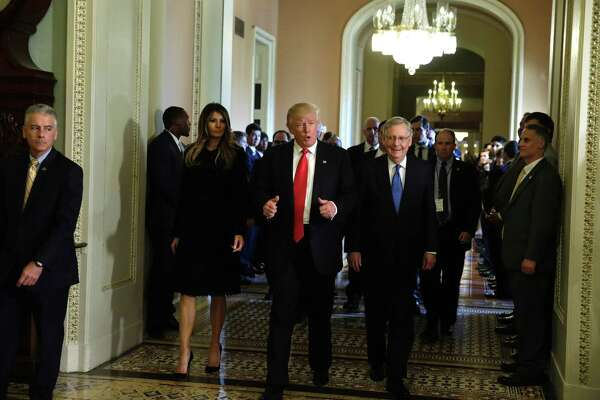 President-elect Donald Trump walks with his wife Melania Trump and Senate Majority Leader Mitch McConnell on Capitol Hill Thursday. It was mostly a deep miasma of angst and hunger for change that propelled Donald Trump into the presidency.