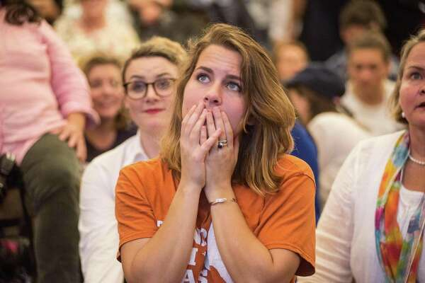 """A Hillary Clinton supporter watches in disbelief as results roll in, during an election night watch party. What does it mean to make our country great """"again"""" if you are despondent about this election outcome? What does it mean if you are fearful of where this election goes? If you are troubled by the anger in the air?"""