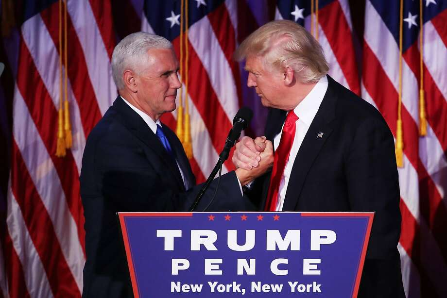 NEW YORK, NY - NOVEMBER 09:  Vice president-elect Mike Pence and Republican president-elect Donald Trump shake hands during his election night event at the New York Hilton Midtown in the early morning hours of November 9, 2016 in New York City. Donald Trump defeated Democratic presidential nominee Hillary Clinton to become the 45th president of the United States.  (Photo by Mark Wilson/Getty Images) Photo: Mark Wilson, Getty Images