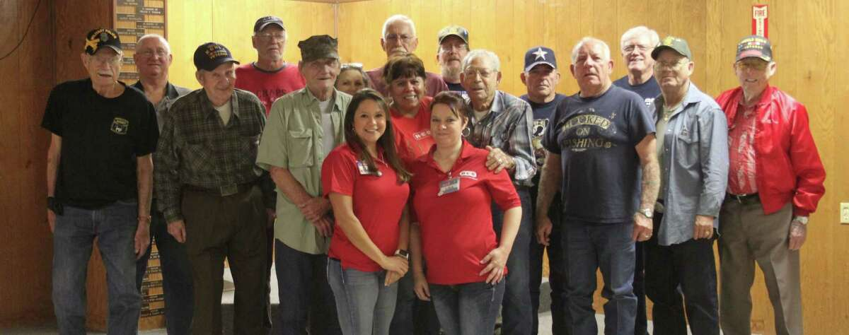 Employees at the Cleveland H-E-B store honor local veterans at VFW Post 1839 by bringing them an early Thanksgiving dinner on Nov. 9.