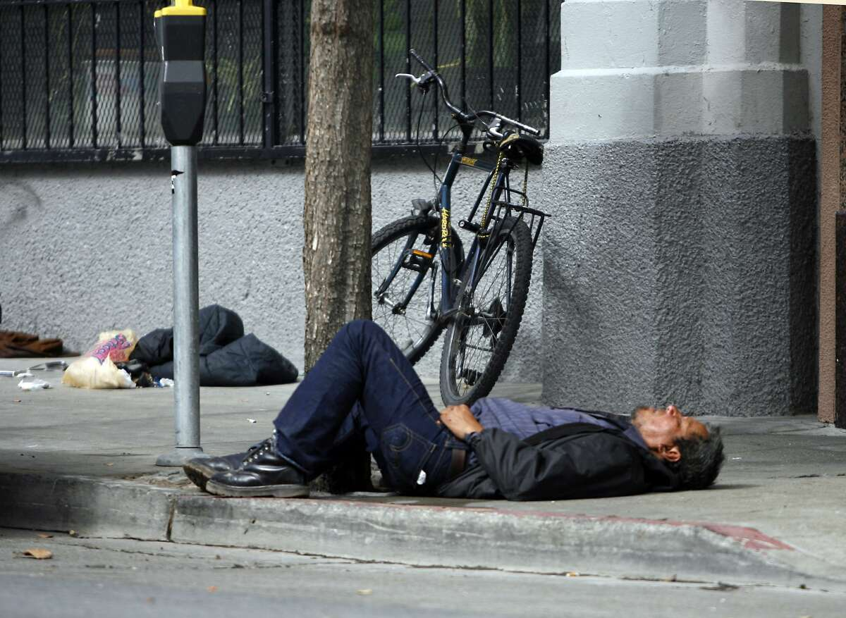 """NEVIUS11_001_KK.JPG San Francisco's new """"sit-lie"""" laws will make it easier for police to cite those sleeping, loitering and aggressively panhandling on city streets. This person was sleeping on Golden Gate and between Jones and Leavenworth at about 12:30 Wednesday. Photo by Kim Komenich/The Chronicle ** Ran on: 10-11-2007 This sleeping person at Larkin and McAllister streets in the early afternoon justifies the question citizens are debating, What do we do about this? Ran on: 10-11-2007 A person lying on the sidewalk is a common sight in San Francisco, as in this street scene Wednesday afternoon at Larkin and McAllister.--- Sent 06/06/12 14:56:20 as insight10_diaz_PH3 with caption:"""