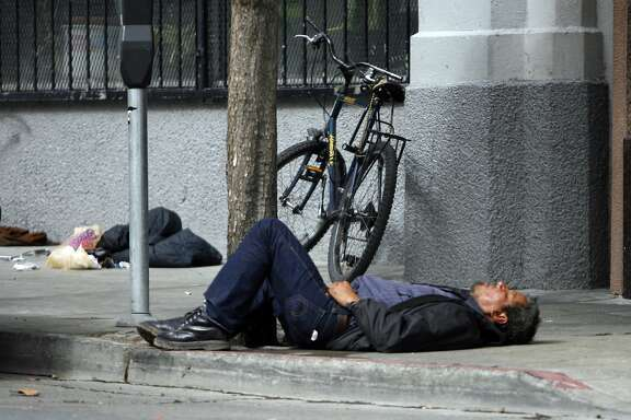 "NEVIUS11_001_KK.JPG San Francisco's new ""sit-lie"" laws will make it easier for police to cite those sleeping, loitering and aggressively panhandling on city streets. This person was sleeping on Golden Gate and between Jones and Leavenworth at about 12:30 Wednesday. Photo by Kim Komenich/The Chronicle **  Ran on: 10-11-2007 This sleeping person at Larkin and McAllister streets in the early afternoon justifies the question citizens are debating, &quo;What do we do about this?&quo; Ran on: 10-11-2007 A person lying on the sidewalk is a common sight in San Francisco, as in this street scene Wednesday afternoon at Larkin and McAllister.--- Sent 06/06/12 14:56:20 as insight10_diaz_PH3 with caption:"