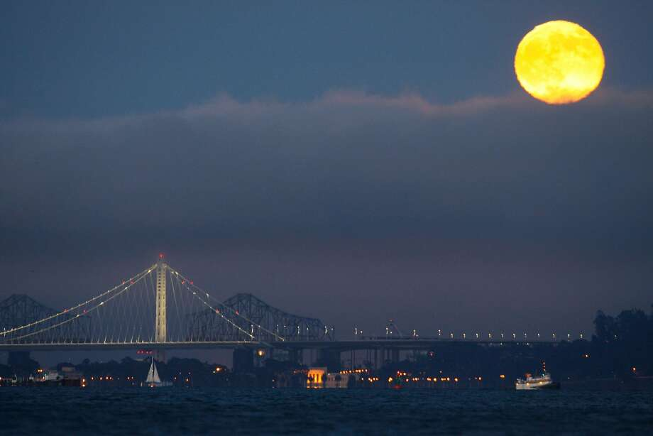 A Supermoon rises over the Eastern Span of the San Francisco/Oakland Bay Bridge on July 12, 2014 as seen from Sausalito, CA. Photo: Craig Hudson, The Chronicle