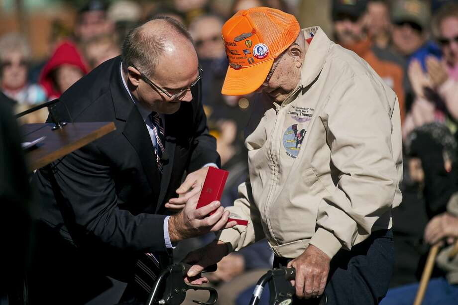 "ERIN KIRKLAND | ekirkland@mdn.net U.S. Congressman John Moolenaar presents World War II veteran Cecil ""Tommy"" Thompson his France's Knight of the Legion of Honor Medal on Friday during a Veterans Day ceremony hosted by The Veterans of Foreign Wars Chemical City Post #3651 at the Midland Veterans Memorial. Photo: Erin Kirkland/Midland Daily News"