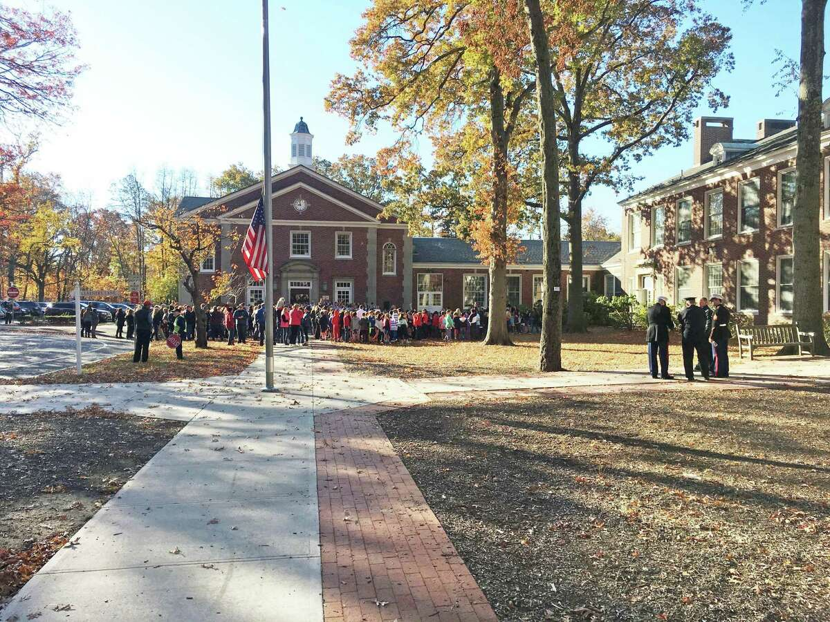 A group of parents, officials and school children attended a Veteran's Day ceremony at Riverside School Friday.