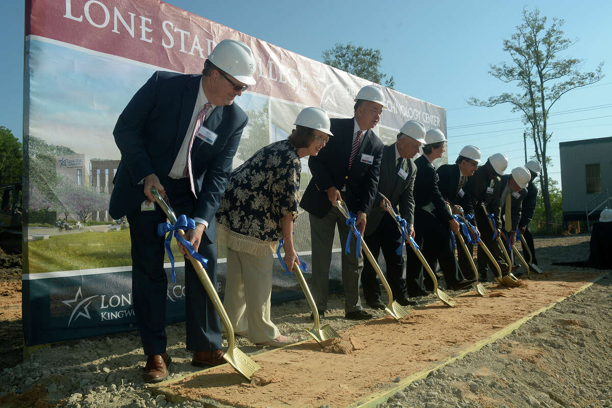 David Baty, from left, Vice President of Instruction, LSC-Kingwood, Linda Good, Chair, LSC Board of Trustees, Dr. Stephen Head, Chancellor, Lone Star College, Congressman Gene Green, Dr. Katherine Persson, President, LSC-Kingwood, and others work their shovels during the Lone Star College Process Technology Center groundbreaking ceremony in Generation Park in Houston on Oct. 4, 2016. (Photo by Jerry Baker/Freelance)