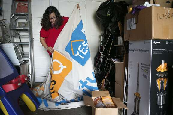 Noelia Corzo folds up a large Measure Q banner inside her garage in San Mateo, Calif. on Friday, Nov. 11, 2016.  Corzo volunteered for the Yes on Measure Q campaign but the rent control initiative was rejected by San Mateo voters.
