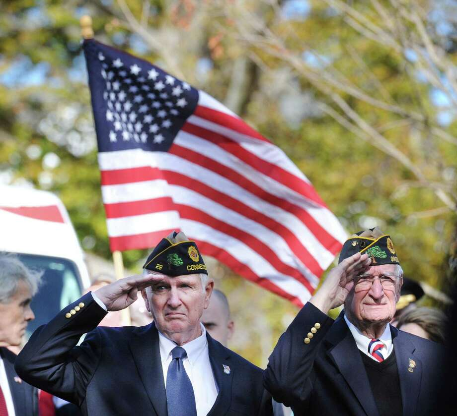 Greenwich Veterans, Carl Peck, 75, left, who served in the U.S. Navy during the beginning of the Vietnam War and Vin Masi, 89, who served in the U.S. Navy during WW II, right, salute the American Flag during the Greenwich Veterans Day Walk & Ceremony in central Greenwich. Photo: Bob Luckey Jr. / Hearst Connecticut Media / Greenwich Time