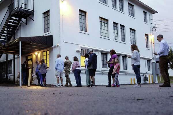 With the presidential election in the rear view mirror, perhaps we can get back to being one nation. Voters wait to enter the Alamo Height Baptist church to vote, Tuesday in San Antonio.
