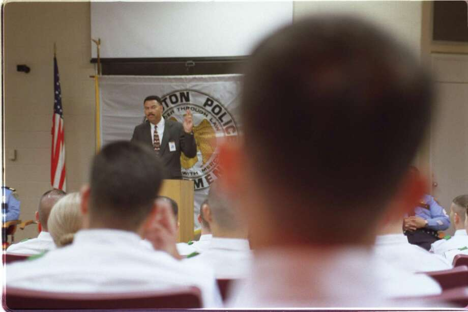 Deescalation techniques are increasingly becoming part of the curriculum in police training. Here, Police Chief C.O. Bradford talks to 70 new cadets at the L.D. Morrison Police Training Academy in 2000. Photo: E. Joseph Deering /Houston Chronicle / Houston Chronicle