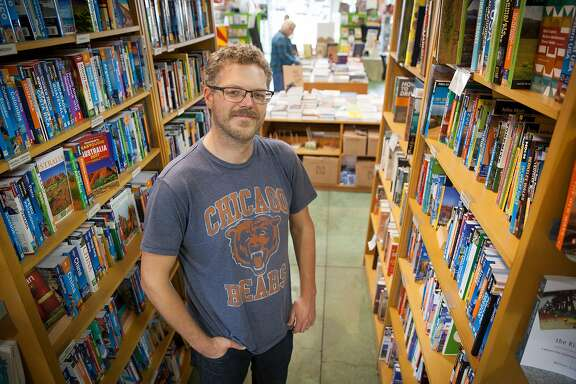 Brad Johnson, co-manager of Oakland's Diesel bookstore who is looking in to a community funded exchange with current owner to transfer and create the East Bay Booksellers in Oakland, California, USA 11 Nov 2016. (Peter DaSilva/Special to The Chronicle)