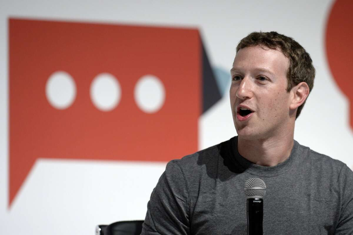 """(FILES) This file photo taken on March 2, 2015 shows Facebook's creator Mark Zuckerberg on the opening day of the 2015 Mobile World Congress (MWC) in Barcelona. Facebook chief Mark Zuckerberg on November 10, 2016 rejected the idea that bogus stories shared at the social network paved a path of victory for President-elect Donald Trump.""""The idea that fake news on Facebook, which is a very small amount of the content, influenced the election in any way I think is a pretty crazy idea,"""" Zuckerberg said during an on-stage chat at a Technonomy technology trends conference in California. / AFP PHOTO / LLUIS GENELLUIS GENE/AFP/Getty Images"""