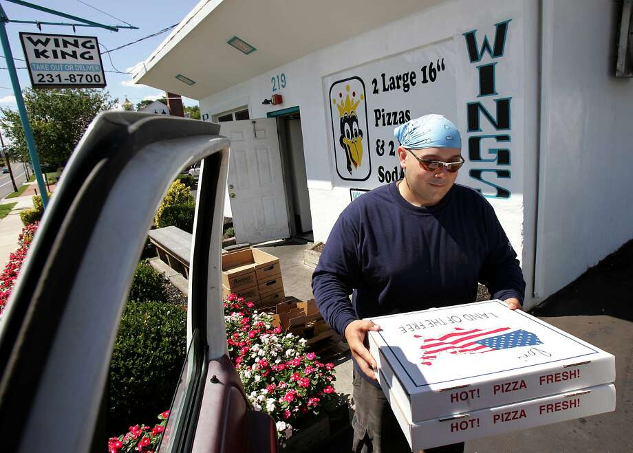 What should you tip on delivery? Photo: Mel Evans, Associated Press