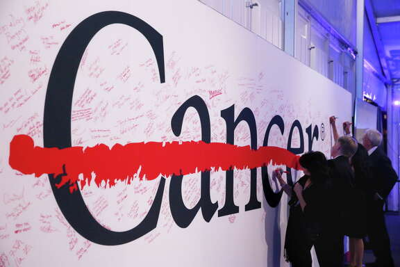 Guests are invited to write their thoughts on a board at the 75th Anniversary Gala of University of Texas MD Anderson Cancer Center Thursday, Nov. 10, 2016, in Houston.
