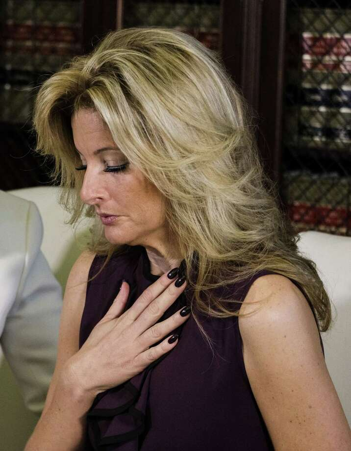 "Summer Zervos appears at a news conference with her attorney Gloria Allred in Los Angeles, Friday Oct. 14, 2016. Zervos, a former contestant on ""The Apprentice"" says Republican presidential candidate Donald Trump made unwanted sexual contact with her at a Beverly Hills hotel in 2007. Photo: Ringo H.W. Chiu / Associated Press / FR170512 AP"