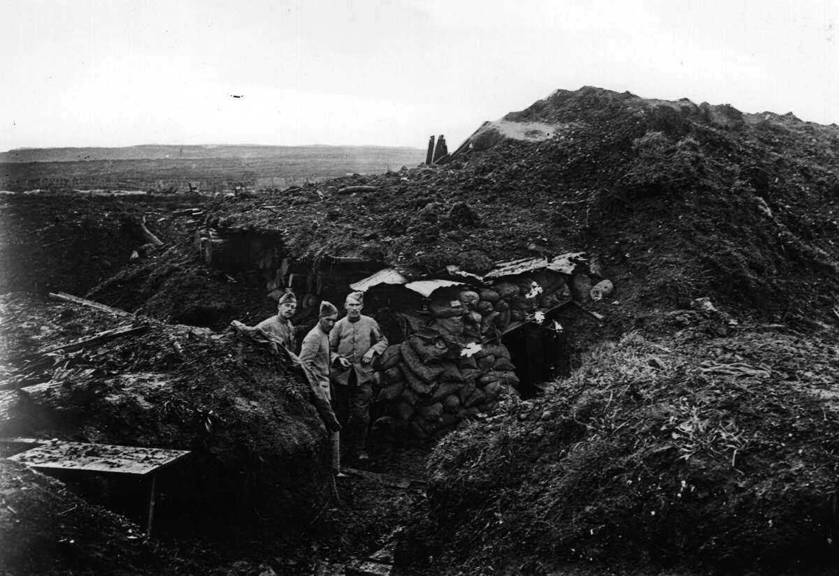 Verdun November 1916: Soldiers in a trench outside a dugout at Verdun.