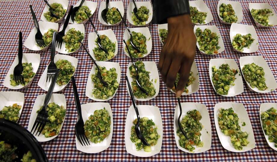 Sherry Carpenter of the Oakland Unified School District prepares the samples of tabbouleh for student taste tests. Photo: Michael Macor, The Chronicle