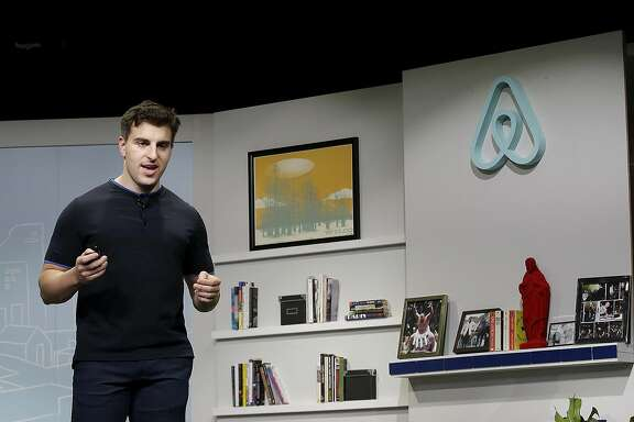 FILE - In this April 19, 2016, file photo, Airbnb co-founder and CEO Brian Chesky speaks during an event in San Francisco. A federal judge refused Tuesday, Nov. 8, 2016, to immediately block a San Francisco ordinance that would fine Airbnb for booking rentals that were not registered with the city, but said he wants to hear more arguments before making a final decision. (AP Photo/Jeff Chiu, File)
