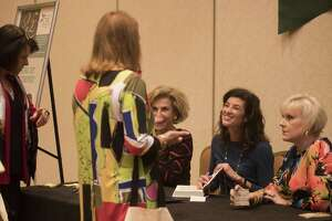 Author Candice Millard autographs a book during the 25th annual Express-News Book & Author Luncheon, which raises funds in the fight against cancer at the Marriott Rivercenter on Friday, November 11, 2016.