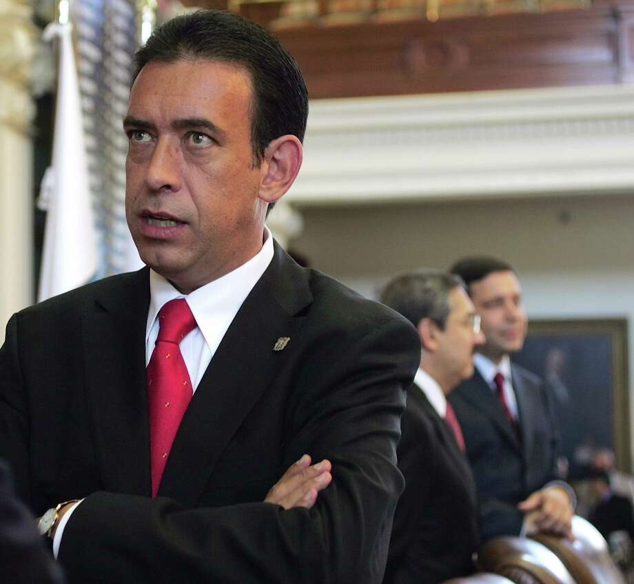 In this Aug. 24, 2006 file photo, Coahuila, Mexico, Gov. Humberto Moreira Valdes talks with another governor before the opening ceremony of the border governors conference in the Texas Capitol in Austin, Texas. Moreira, head of Mexico's Institutional Revolutionary Party, PRI, resigned Friday, Dec. 2, 2011 over a financial scandal that threatened the party's efforts to rebrand itself as corruption-free and retake the presidency in 2012. (AP Photo/Harry Cabluck, File) Photo: Harry Cabluck, STF / AP / AP