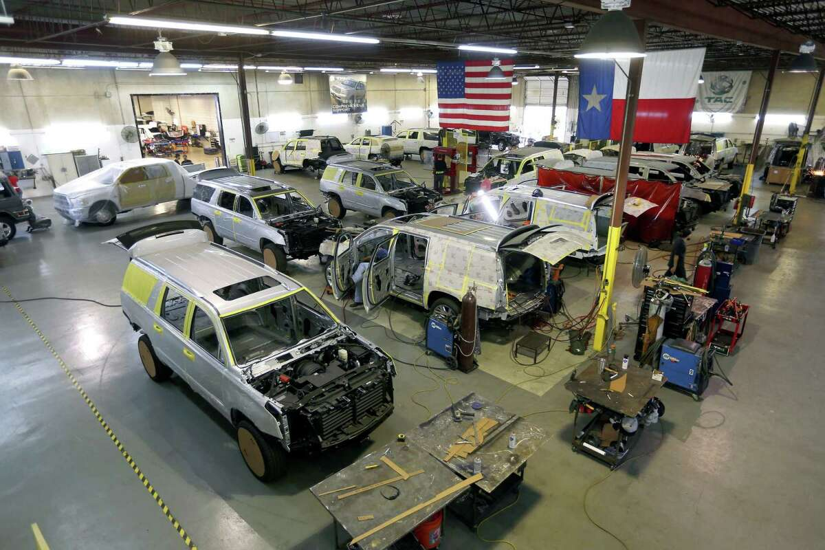 Vehicles undergoing armoring are seen inside Texas Armoring Corporation's San Antonio facility. The company is building a new 50,000-square-foot facility in Honduras to meet bulk vehicle demand.