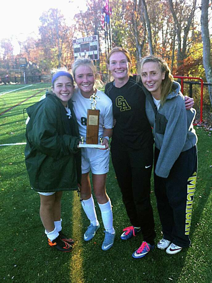 From left to right, seniors Graiden Berger, Chapin Ruffa, Meghan Keating and Parker Murphy after Greenwich Academy's 2-0 win at Hopkins in the FAA girls soccer championship on Friday. Photo: Contributed Photo / Contributed Photo / Greenwich Time Contributed