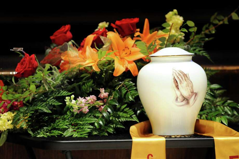 An urn containing the ashes of Tylar Zielinski is on display during his memorial service on Thursday, July 12, 2012, at Fonda Fultonville High School in Fonda, N.Y. Tylar died at the age of 20 from Duchenne muscular dystrophy. (Cindy Schultz / Times Union) Photo: Cindy Schultz / 00018413A