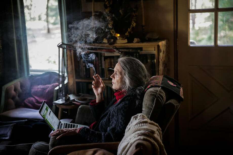 "Nikki Lastreto, who co-founded the cannabis brand Swami Select with husband, Swami Chaitanya, smokes a joint while working on her laptop. ""To be a small grower will be equal to being a vintner in Napa,"" she says. Photo: Gabrielle Lurie, The Chronicle"